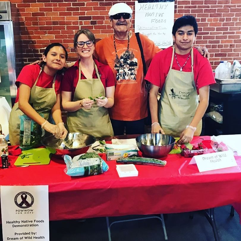 Youth Leaders doing a healthy salad demonstration at Pow Wow for Hope