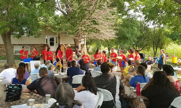 DWH Staff and community members celebrating at the Garden Warriors Session 2 Feast, 2019.